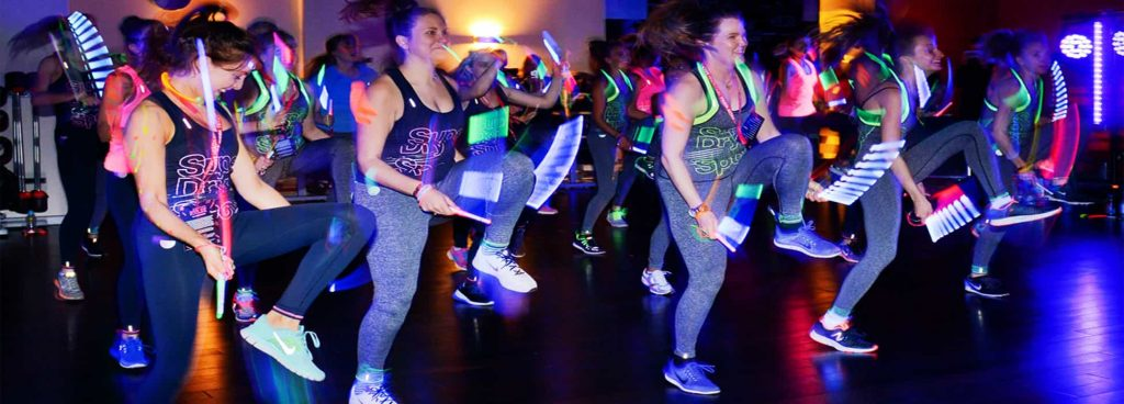 Clubbercise dancing with glowing sticks